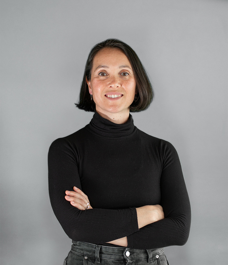 Photo of Jade Lucas in a black jersey on a grey background